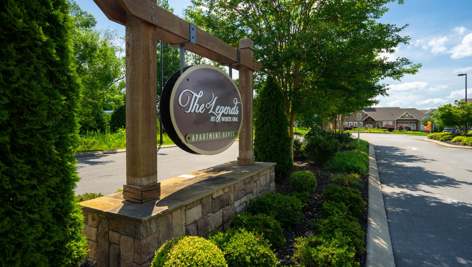 Beautifully maintained landscaping at the entrance to Legends at White Oak in Ooltewah, Tennessee