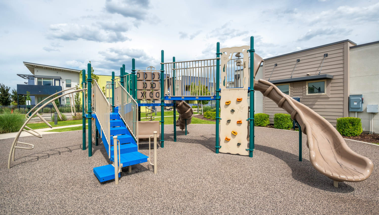 Slide, climbing area, and more at the playground at Olympus at Daybreak in South Jordan, Utah