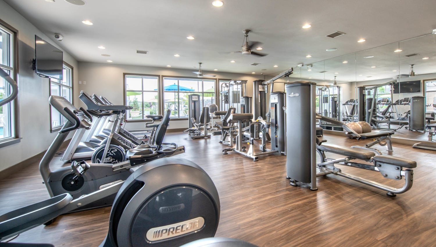 Large fitness center with ample equipment and stations at Olympus at Daybreak in South Jordan, Utah