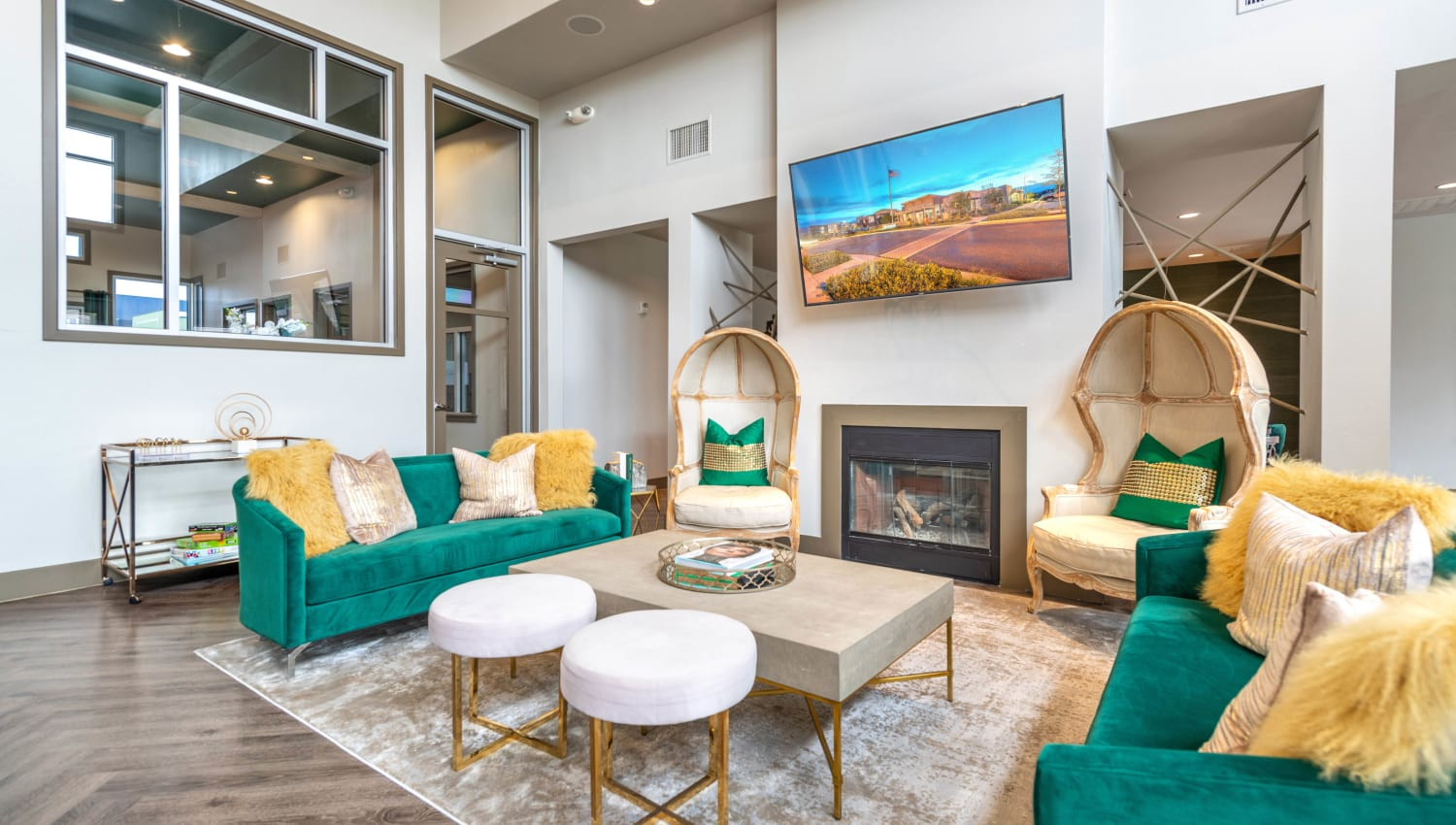 Lounge area near the fireplace in the resident clubhouse at Olympus at Daybreak in South Jordan, Utah