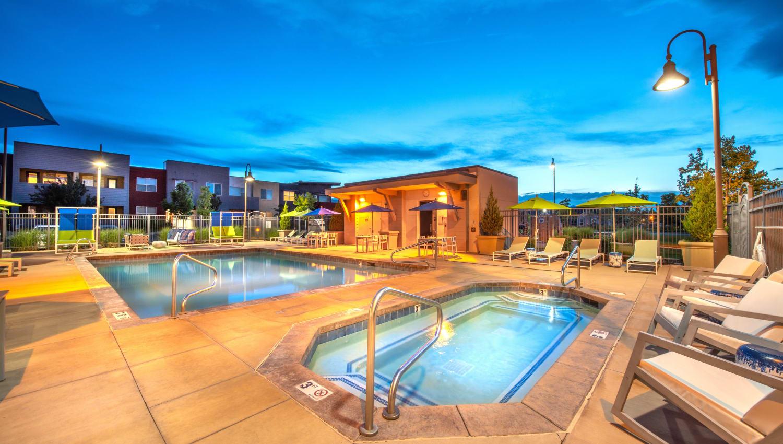 Spa and pool area at dusk at Olympus at Daybreak in South Jordan, Utah