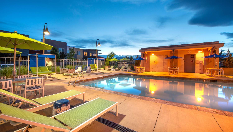 Dusk view of the pool area at Olympus at Daybreak in South Jordan, Utah