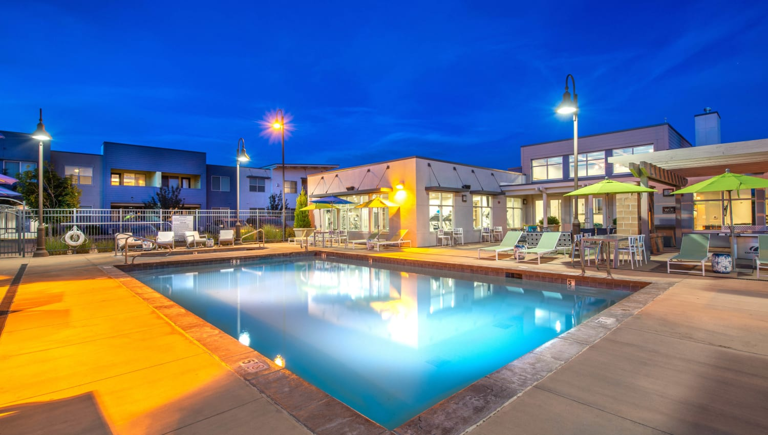 Early evening at the swimming pool with underwater lights on at Olympus at Daybreak in South Jordan, Utah