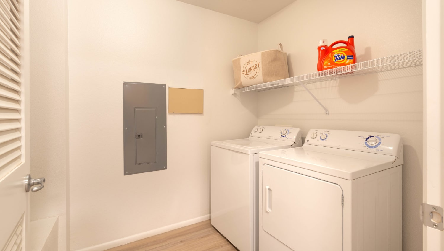 Full-size in-unit washer and dryer in a model apartment at Olympus at Daybreak in South Jordan, Utah