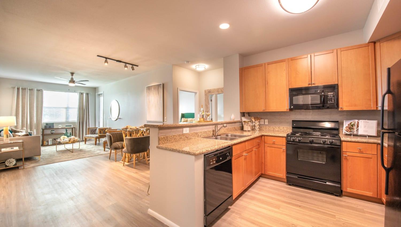 Gourmet kitchen with granite countertops in a model home at Olympus at Daybreak in South Jordan, Utah