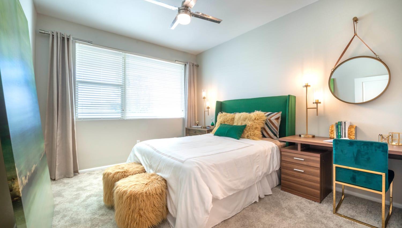 Draped bay windows in a model home's master bedroom at Olympus at Daybreak in South Jordan, Utah