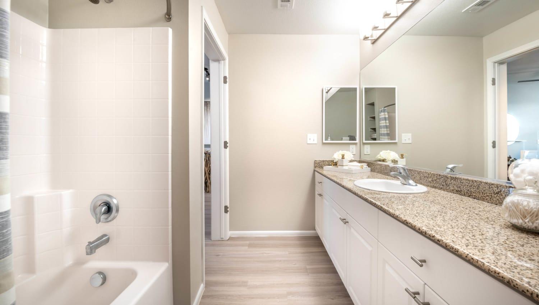 Dual sinks in a model apartment's master bathroom at Olympus at Daybreak in South Jordan, Utah