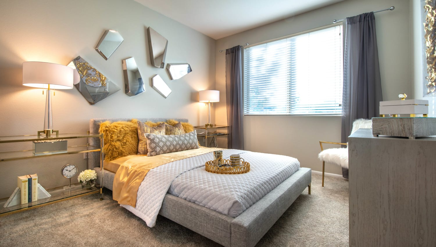 Well-furnished master bedroom in a model home at Olympus at Daybreak in South Jordan, Utah