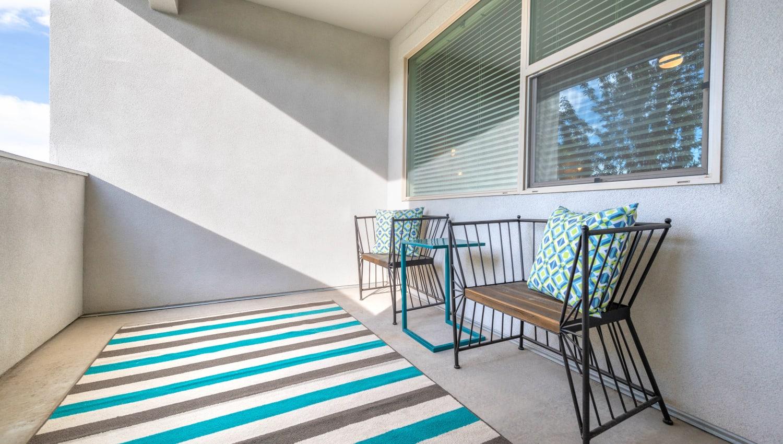 Private balcony outside a model home at Olympus at Daybreak in South Jordan, Utah
