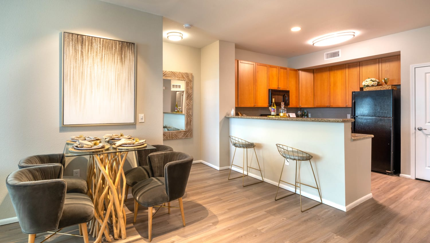 View of the kitchen over the breakfast bar from a model home's dining nook at Olympus at Daybreak in South Jordan, Utah