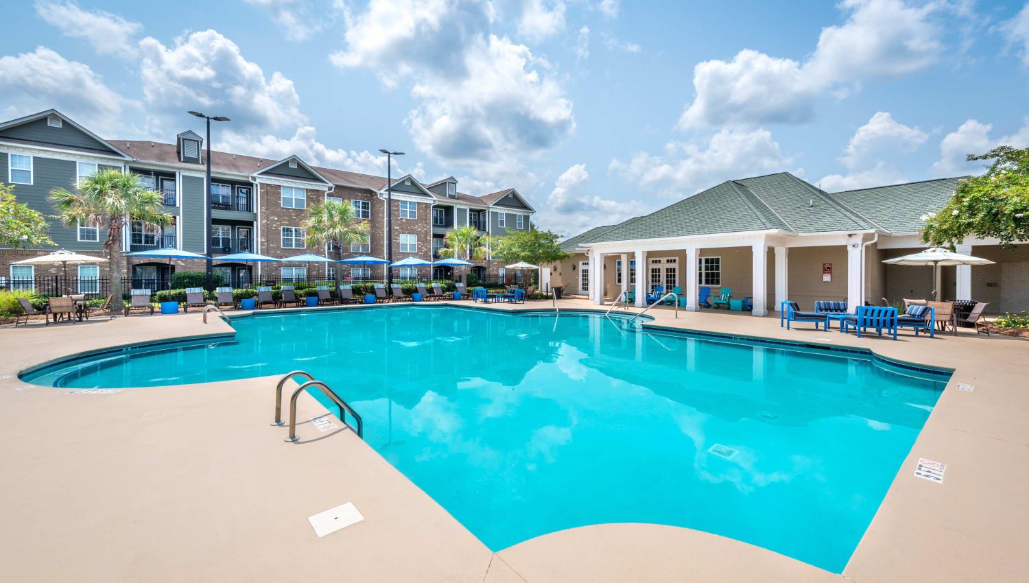 Resort-style swimming pool on a sunny day at Olympus Carrington in Pooler, Georgia
