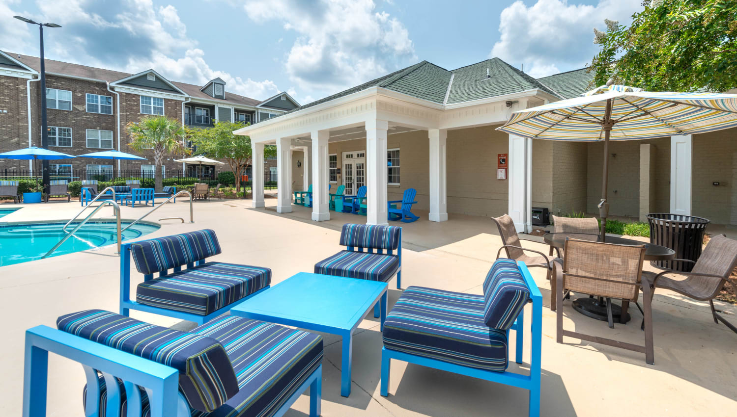 Lounge area next to the pool at Olympus Carrington in Pooler, Georgia