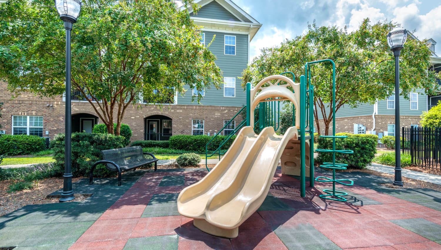 Slide and more at the onsite children's playground at Olympus Carrington in Pooler, Georgia