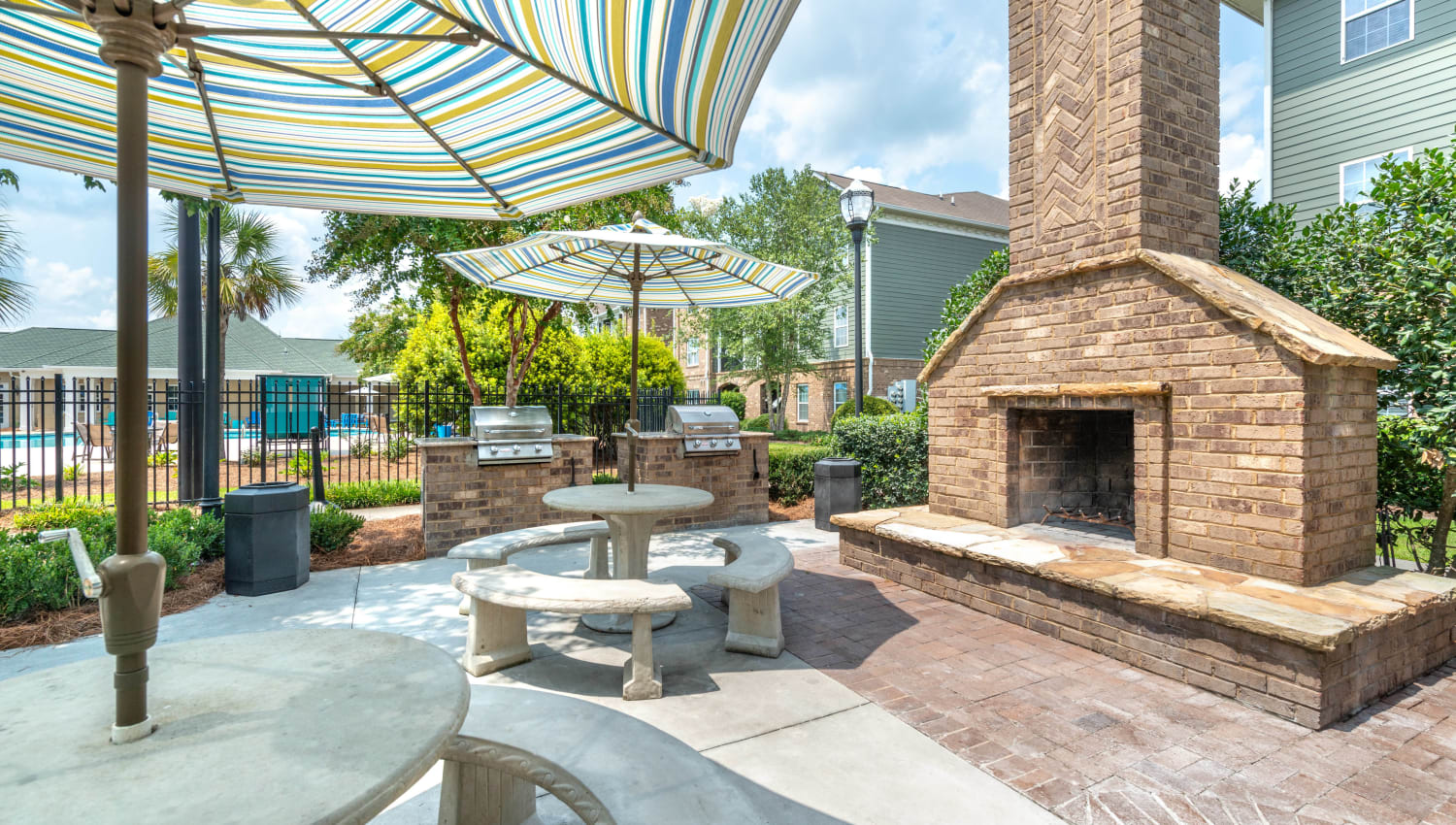 Lounge area in front of the fire pit at Olympus Carrington in Pooler, Georgia