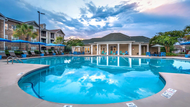 Beautiful view of the swimming pool area at dawn at Olympus Carrington in Pooler, Georgia