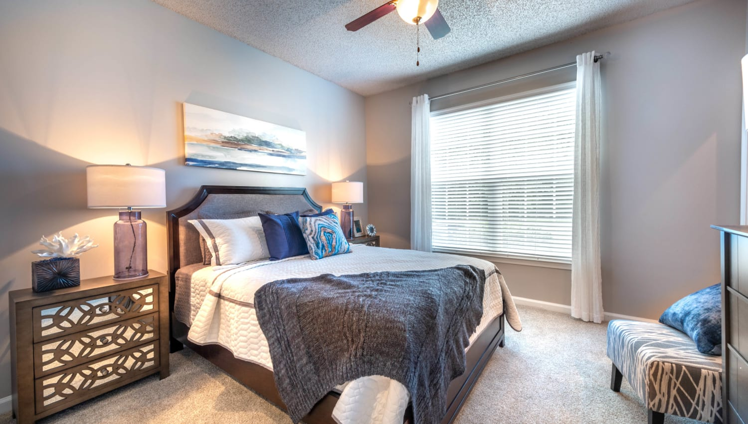 Plush carpeting and a ceiling fan in the guest bedroom of model home at Olympus Fenwick in Savannah, Georgia