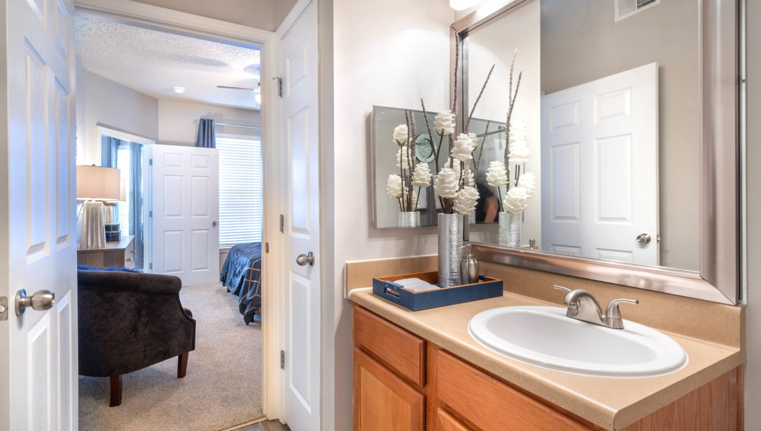 Guest bathroom with a large vanity mirror in a model home at Olympus Fenwick in Savannah, Georgia