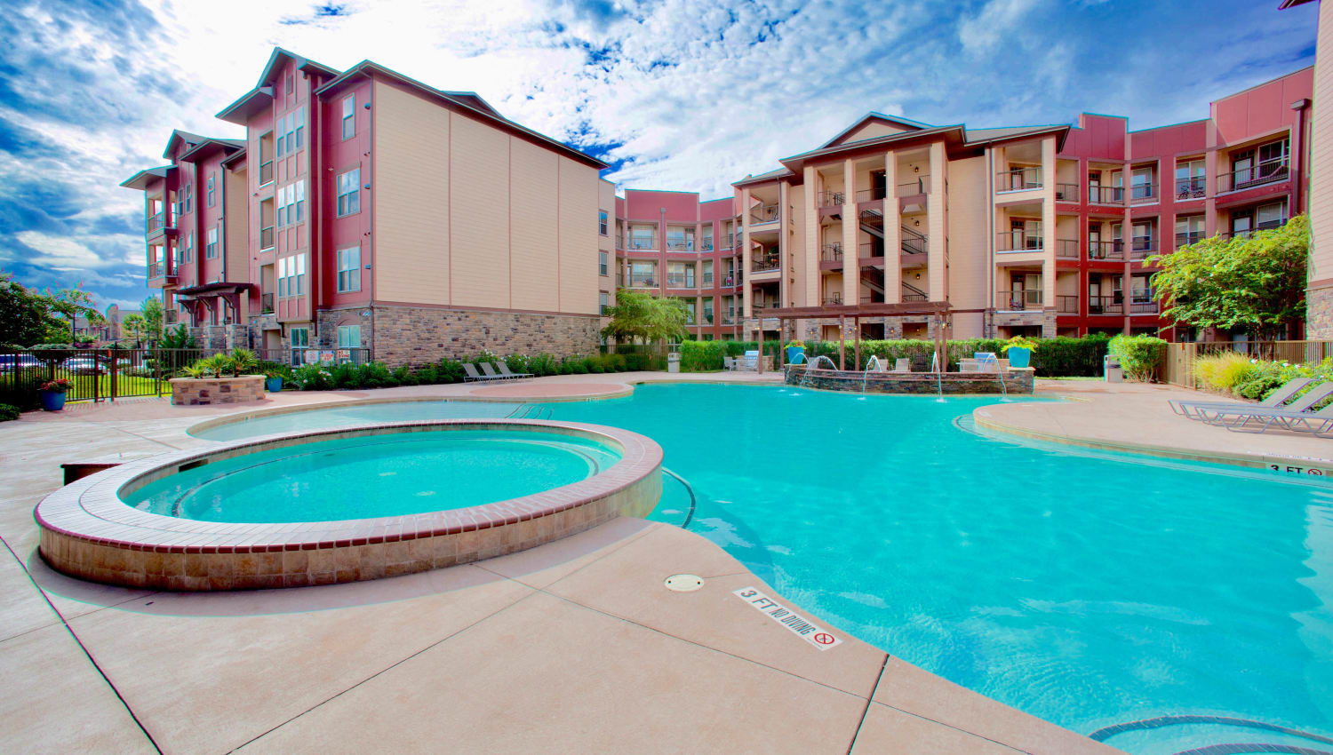 Swimming pool and spa area on a sunny afternoon at Olympus Katy Ranch in Katy, Texas