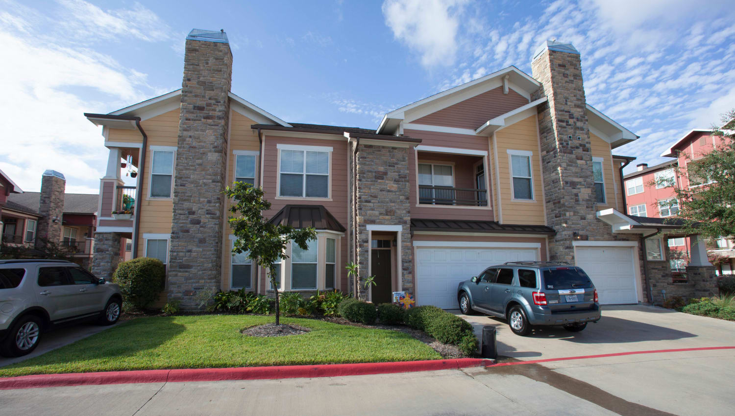 Townhomes with private garages attached at Olympus Katy Ranch in Katy, Texas