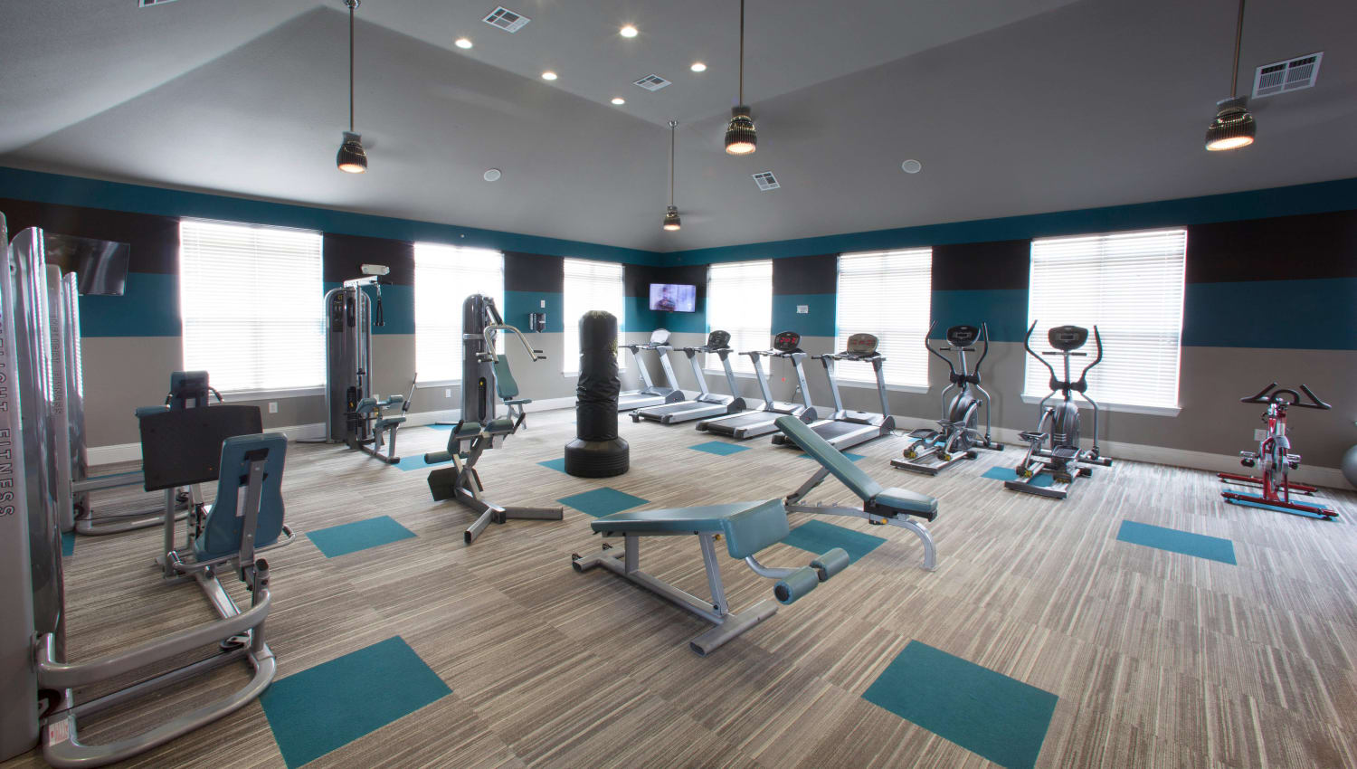 Fully equipped fitness center at Olympus Katy Ranch in Katy, Texas