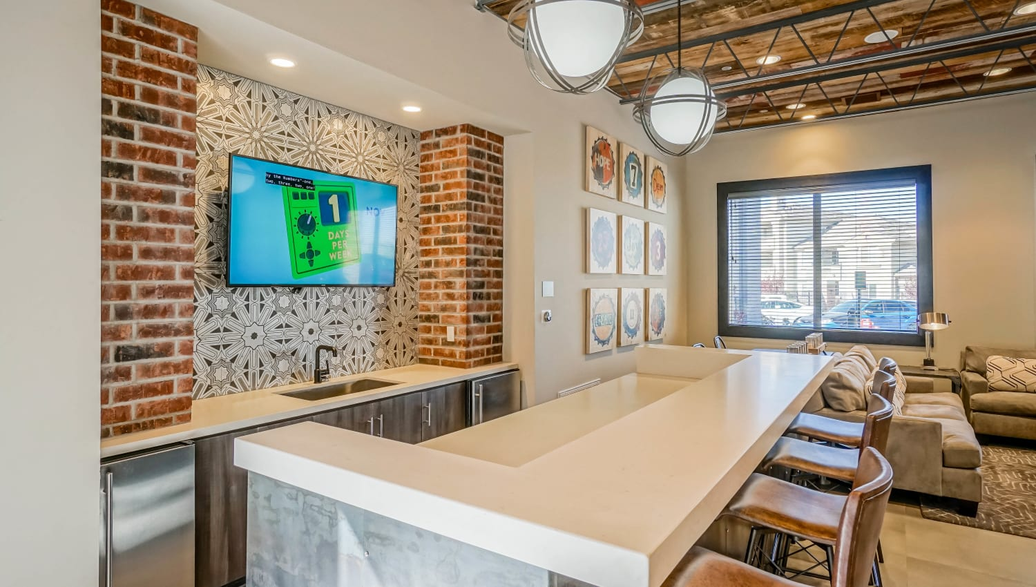Bar seating and a flatscreen TV in the clubhouse kitchen at Olympus Northpoint in Albuquerque, New Mexico