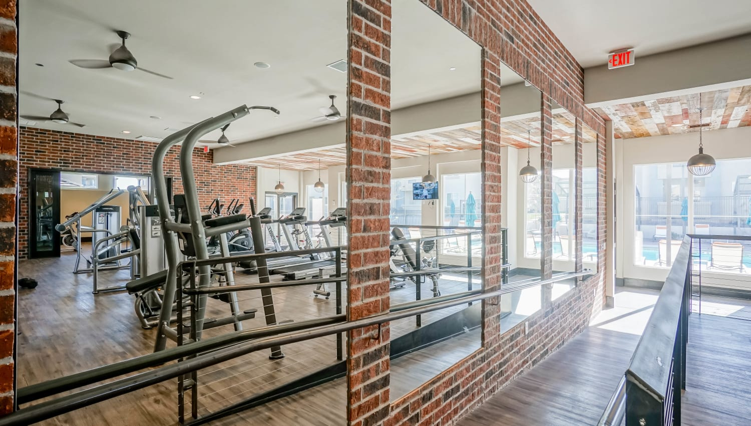 Equipment reflected in the full-length mirrors in the fitness center at Olympus Northpoint in Albuquerque, New Mexico
