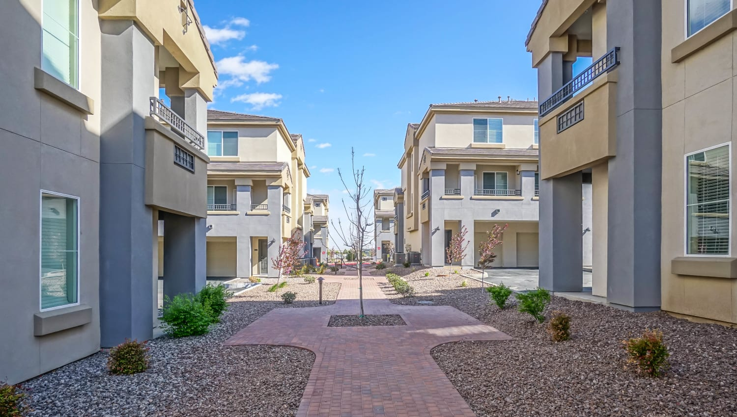 Brick walkways between resident buildings at Olympus Northpoint in Albuquerque, New Mexico