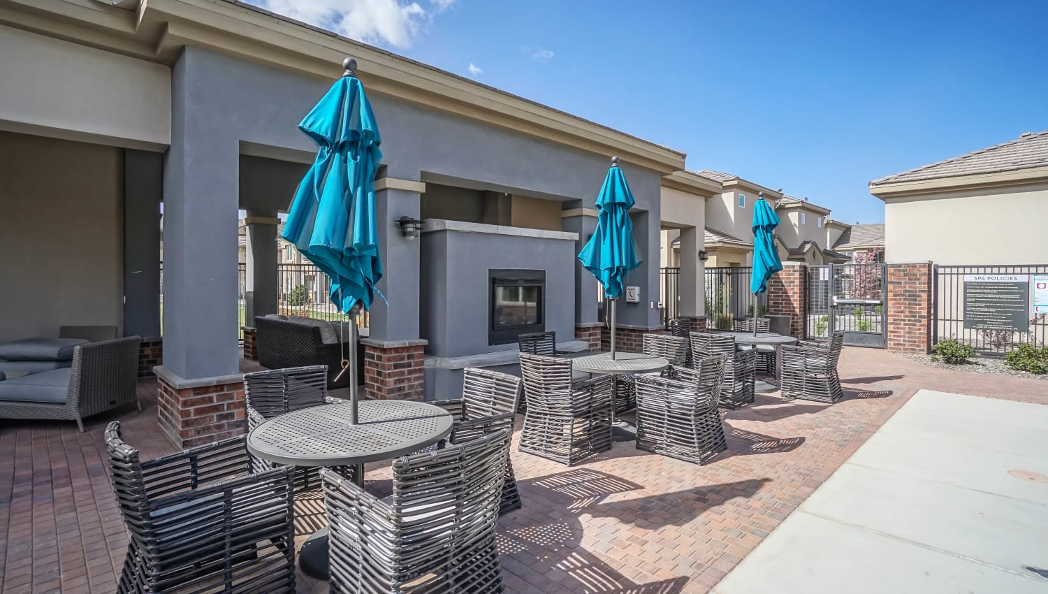 Outdoor fireplace and lounge area at Olympus Northpoint in Albuquerque, New Mexico