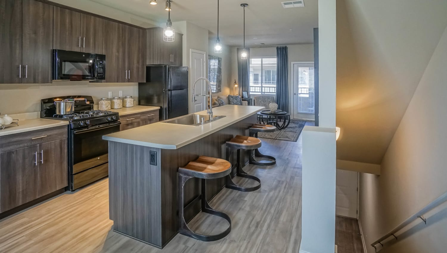 Chef's kitchen with quartz countertops in a model townhome at Olympus Northpoint in Albuquerque, New Mexico