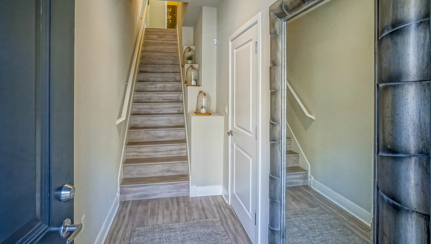 Stairs to the upper floor from the entrance of a model townhouse at Olympus Northpoint in Albuquerque, New Mexico