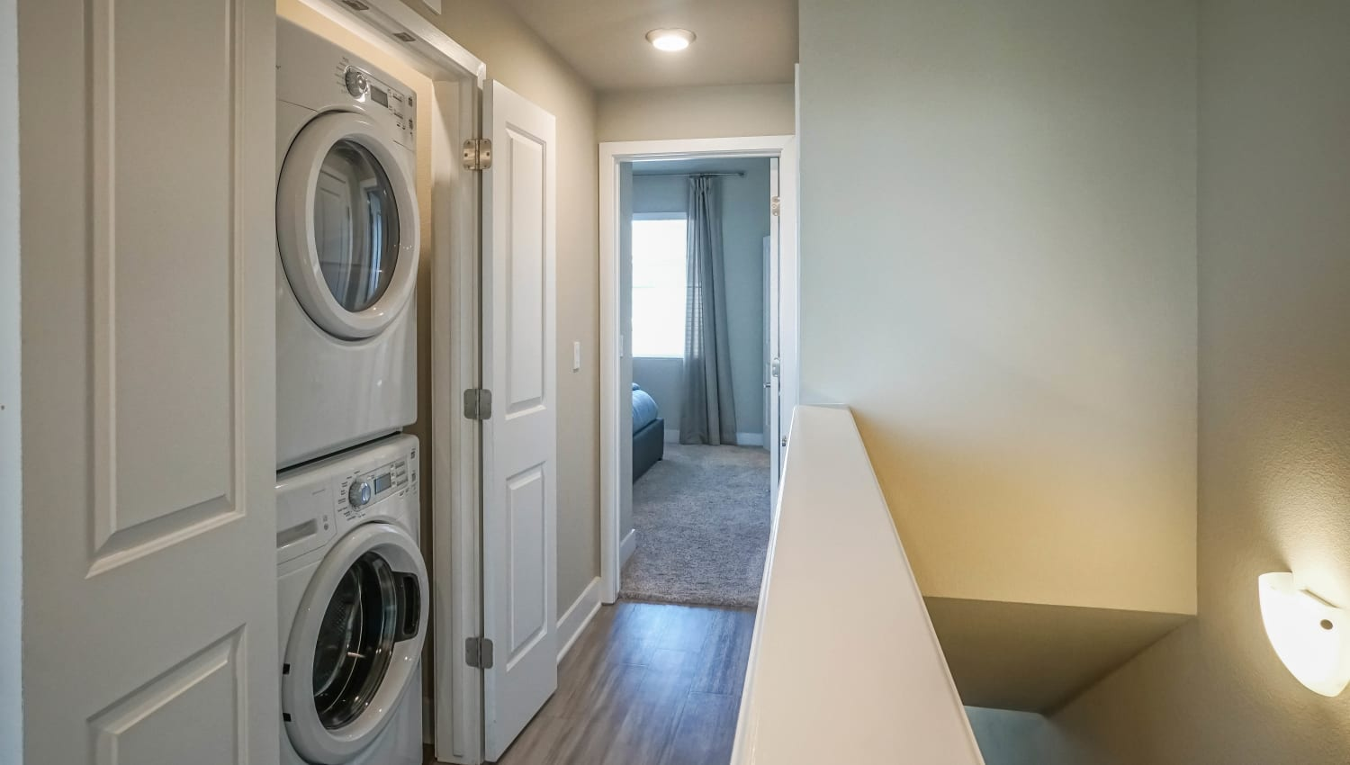 Stacked washer and dryer in a model townhome at Olympus Northpoint in Albuquerque, New Mexico