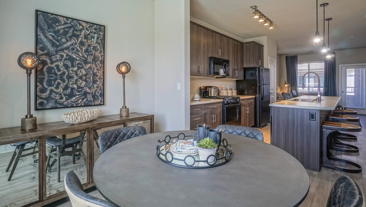 Dining area looking into the kitchen of a model townhome at Olympus Northpoint in Albuquerque, New Mexico