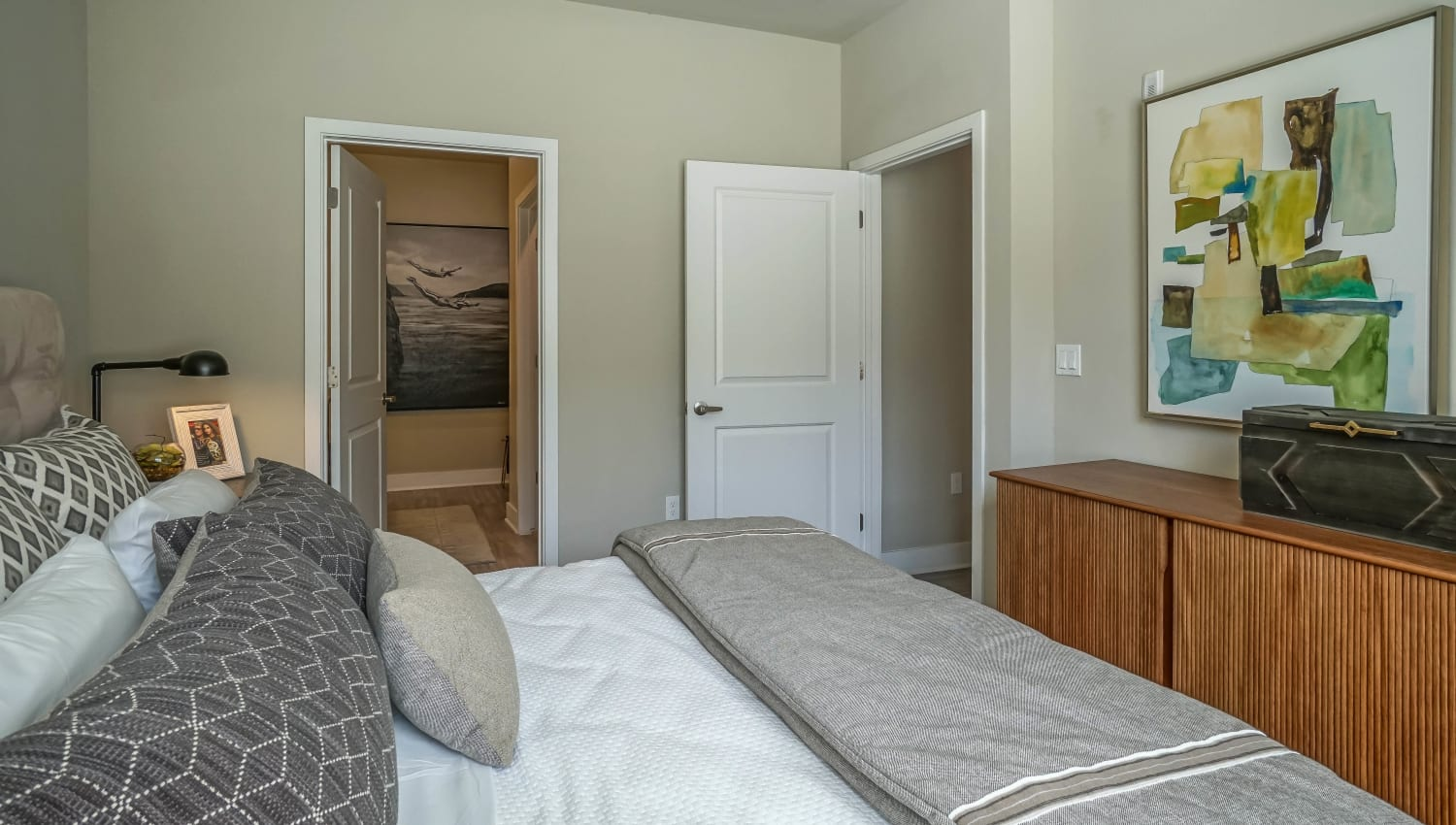 Model home's bedroom with an en suite bathroom at Olympus Northpoint in Albuquerque, New Mexico