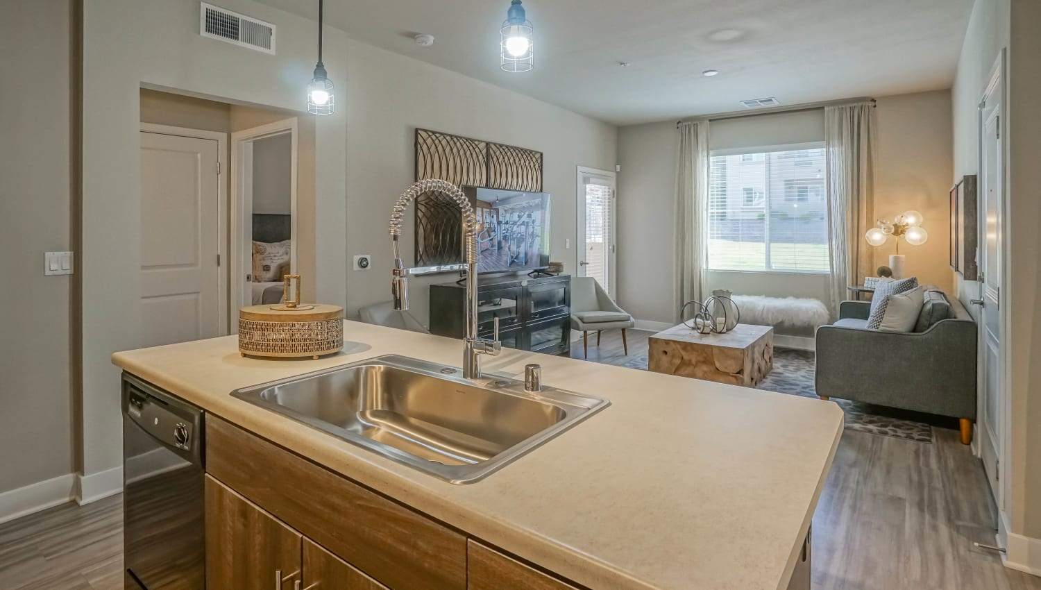 Model apartment's kitchen with quartz countertops at Olympus Northpoint in Albuquerque, New Mexico