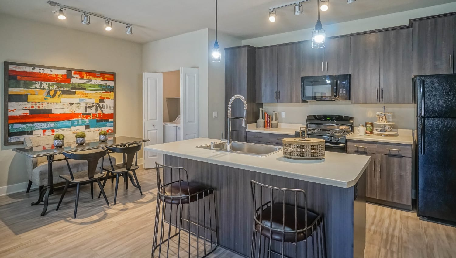 Bar seating at the kitchen island in a model townhome at Olympus Northpoint in Albuquerque, New Mexico