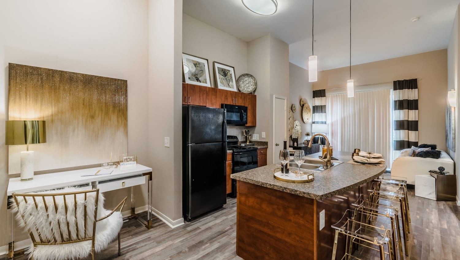 Gourmet kitchen with ample space at Olympus Boulevard in Frisco, Texas