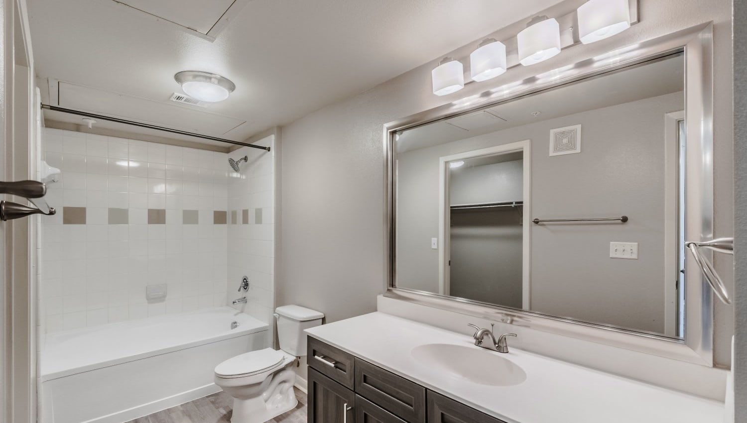 Shower and tub of model apartment at Olympus Boulevard in Frisco, Texas