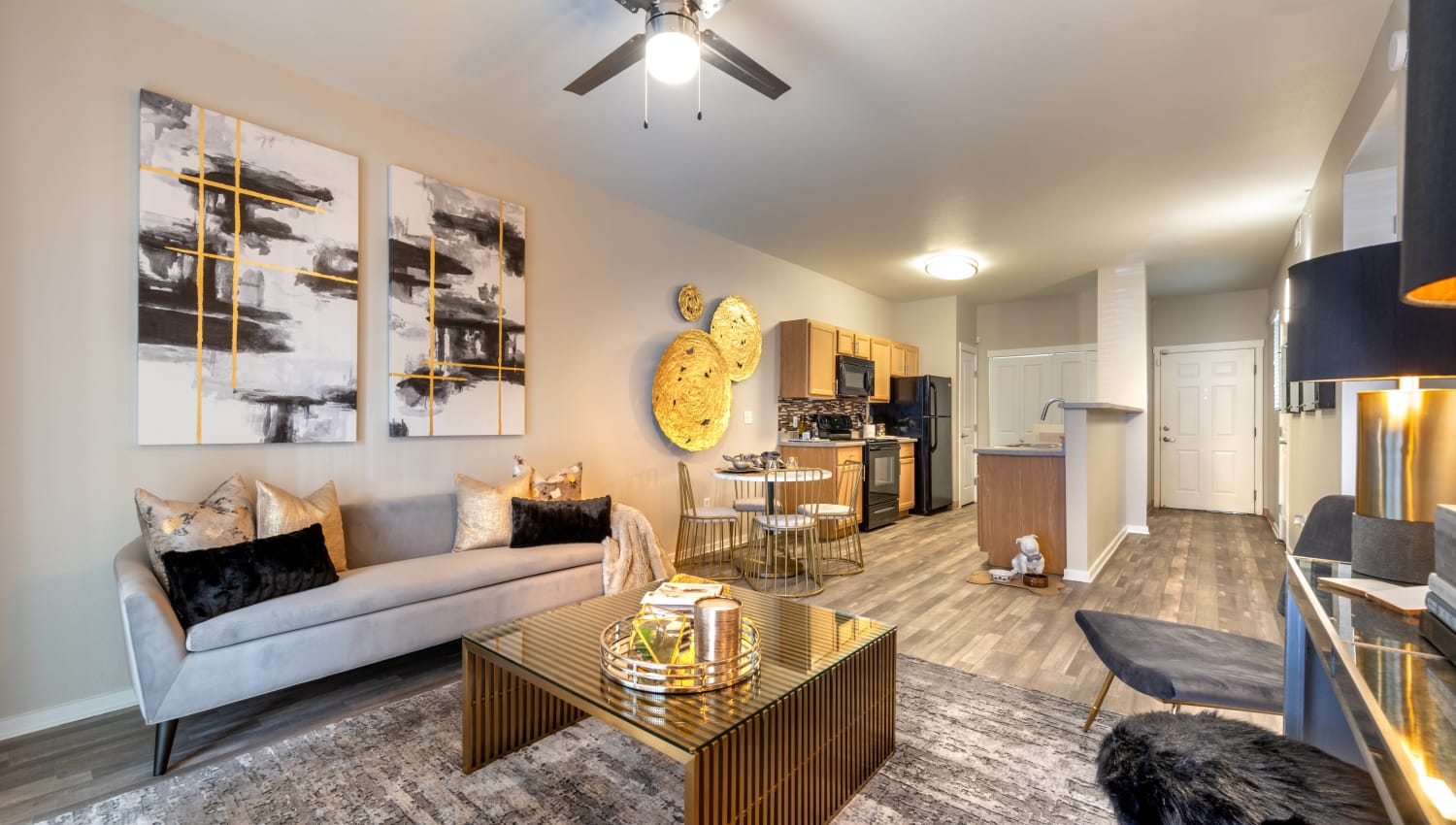 Model apartment with hardwood floors throughout the living area at Olympus Solaire in Albuquerque, New Mexico