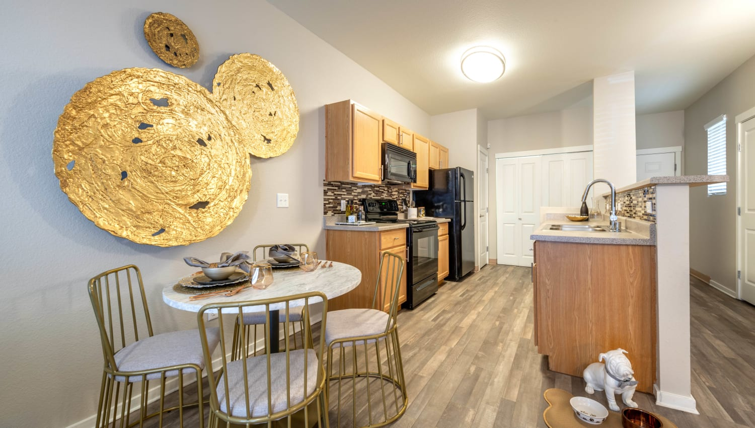 Dining area near the open-concept kitchen in a model apartment at Olympus Solaire in Albuquerque, New Mexico