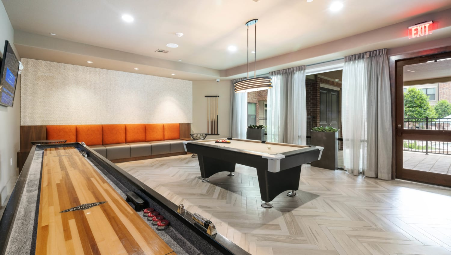 Game room with tabletop shuffleboard and billiards at Olympus Sierra Pines in The Woodlands, Texas