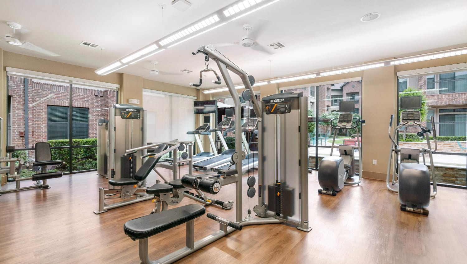 Ample exercise equipment in the fitness center at Olympus Sierra Pines in The Woodlands, Texas