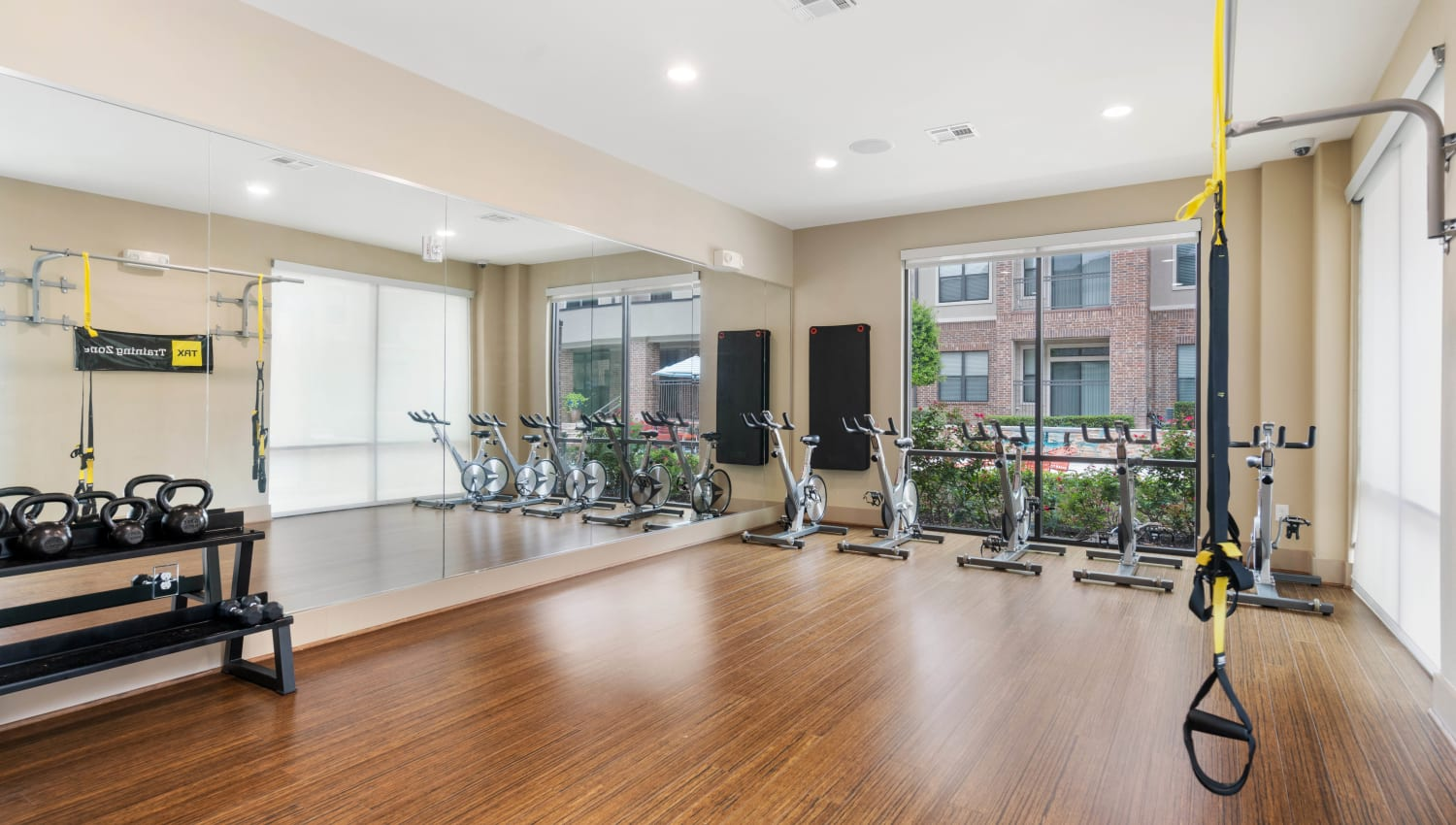 Spin class and yoga room in the fitness center at Olympus Sierra Pines in The Woodlands, Texas