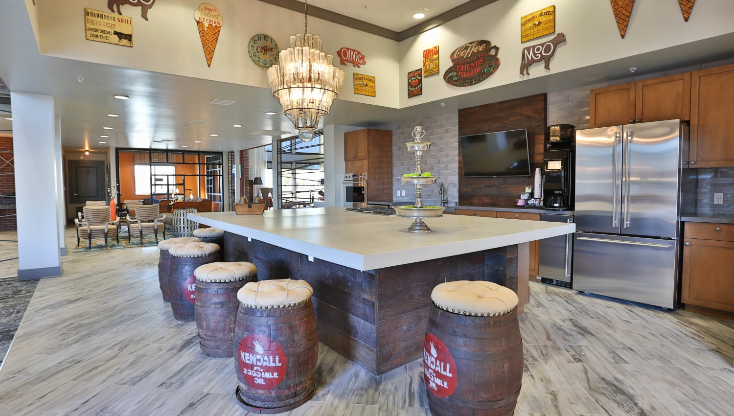 Demonstration kitchen with a large bar-style table in the clubhouse at Olympus Steelyard in Chandler, Arizona