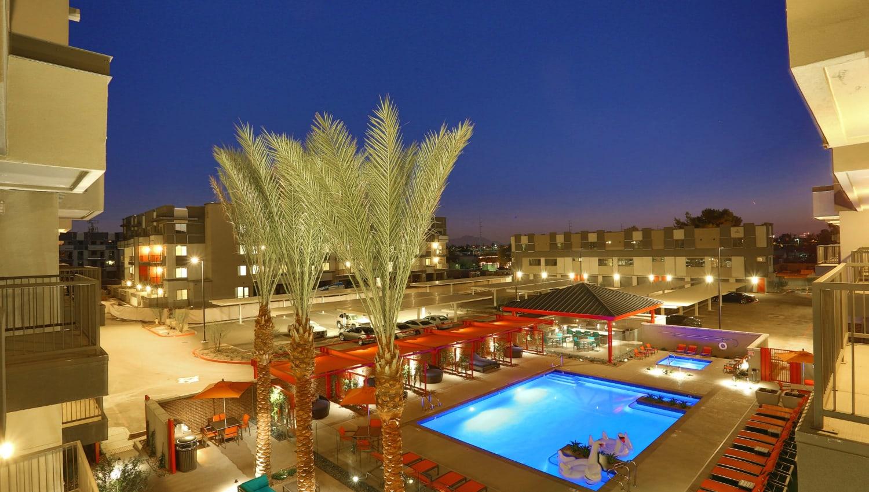 Upper floor view of the pool area at dusk at Olympus Steelyard in Chandler, Arizona