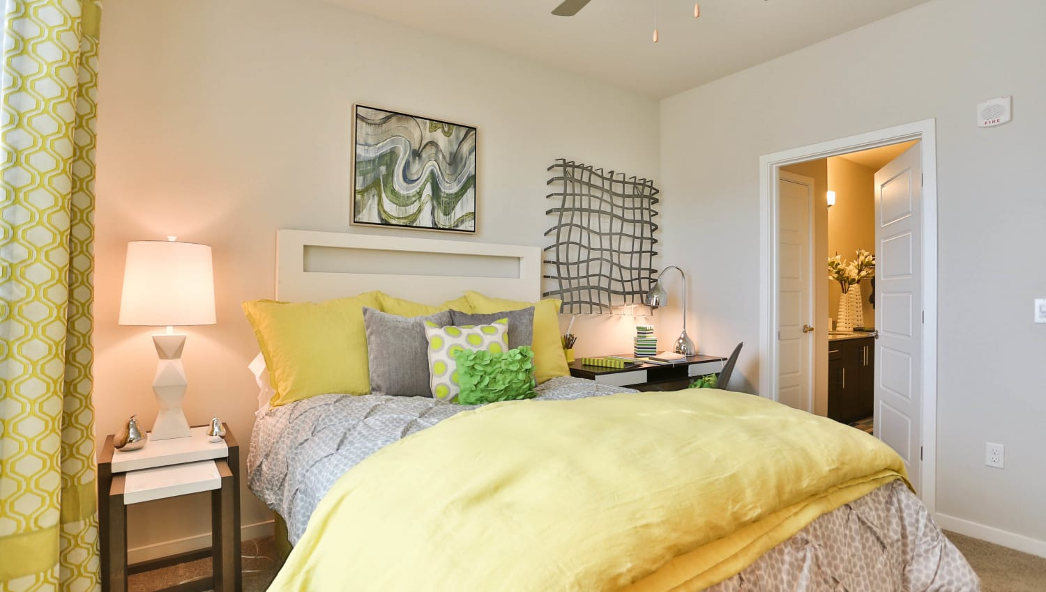 Model home's brightly decorated bedroom at Olympus Steelyard in Chandler, Arizona