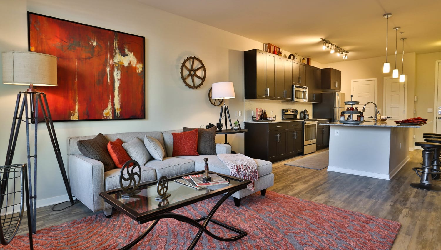Modern art and classic furnishings in the living area of model apartment at Olympus Steelyard in Chandler, Arizona