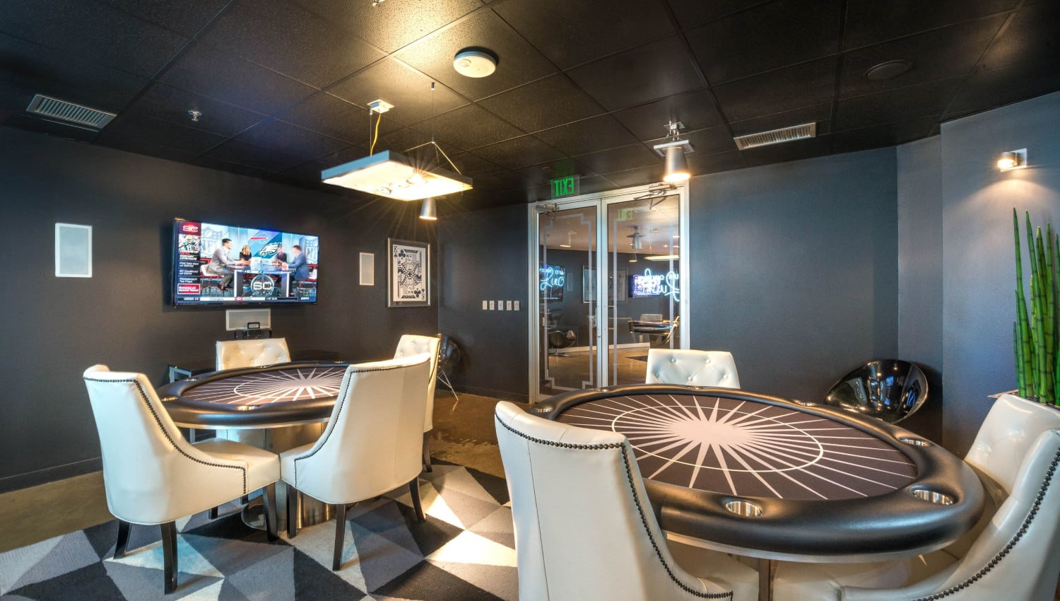 Poker tables in clubhouse at Mosaic Dallas in Dallas, Texas