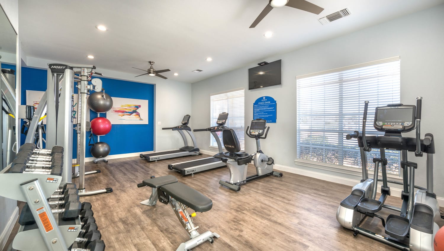 Well-equipped onsite fitness center at Olympus Stone Glen in Keller, Texas