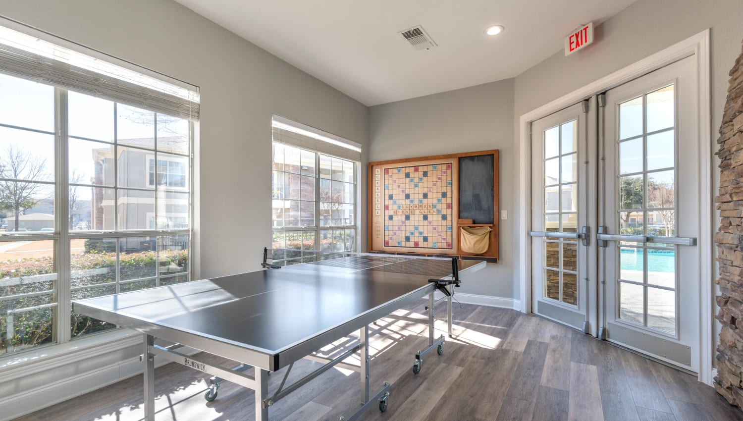 Game room with a ping pong table at Olympus Stone Glen in Keller, Texas