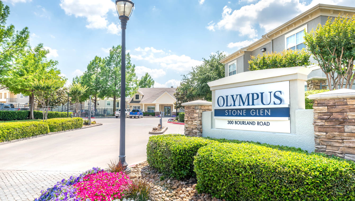 Our monument sign welcoming residents and guests to Olympus Stone Glen in Keller, Texas